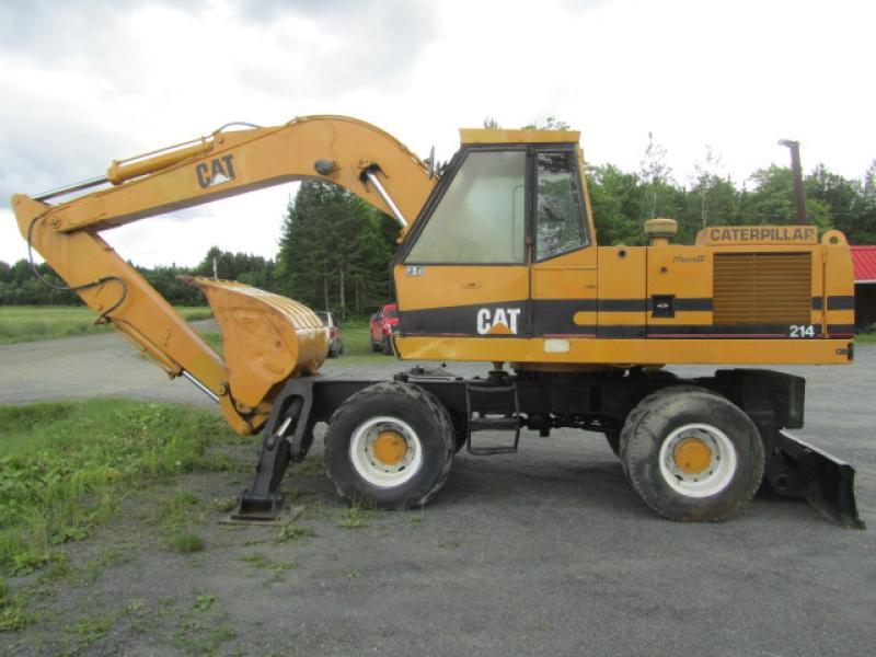 Excavatrice sur roues Caterpillar 214 1986 En Vente chez EquipMtl
